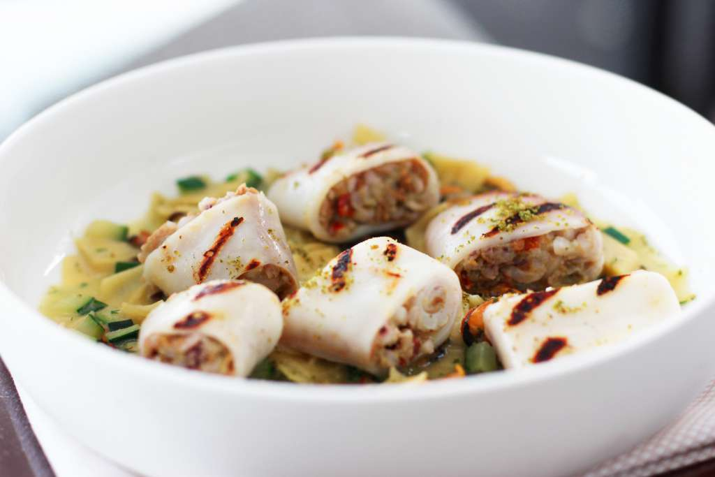 Stuffed squid garnished with pasta